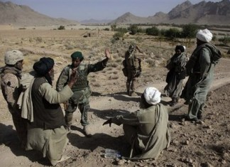 Afghan Civilian talking with a soldier from the Afghan Security Force